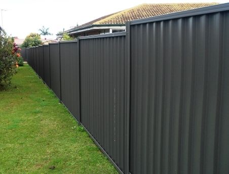 Colorbond & Steel Fence - too dark for back fence?  Shrubs in front to 'lighten' it?