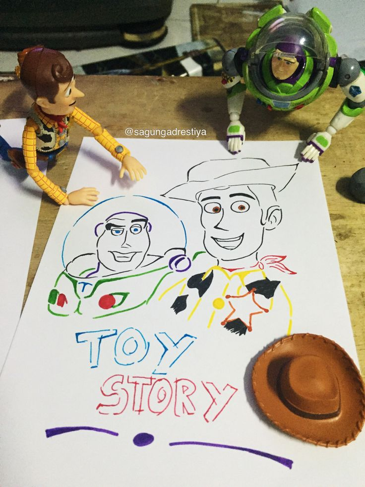 Woody : wow .. this is us!  Buzz : yap! I like she to draw us  Toy Story