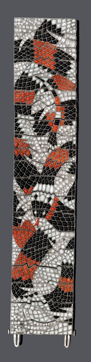 AN ART DECO PLATINUM, DIAMOND, ONYX, MOTHER OF PEARL AND CORAL BRACELET, CIRCA 1935. Of abstract design and stylised palm leaf motifs, set with calibré-cut onyx, mother of pearl, coral and circular-cut diamonds.