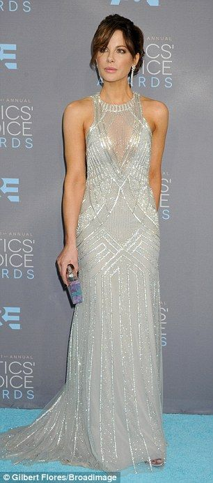 Figure-hugging: The English actress' gown was sleeveless and fit her slender form snugly b...