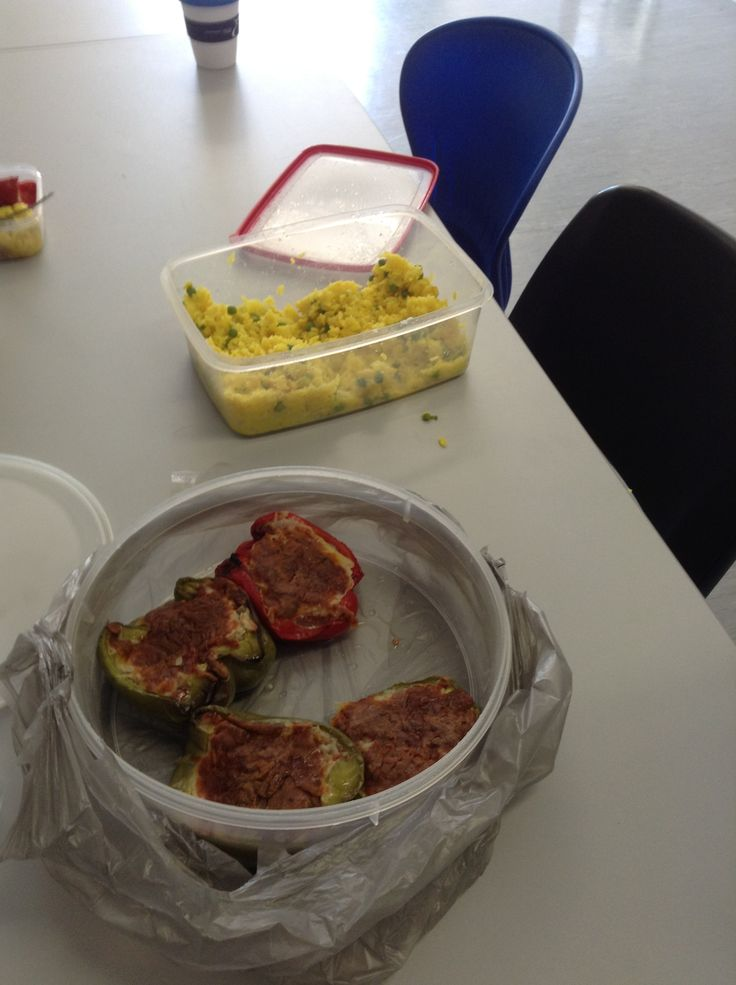 Lunch by Nikki - curried rice cooked in chicken stock and Stuffed Capsicum ( rice, mixed Italian herbs, mushroom, bacon, cheese topping)