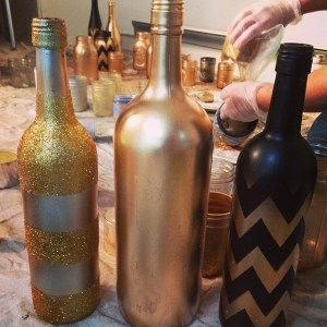 DIY Wine bottle makeover, spray paint, glitter, patterns, chevron, centerpiece, roaring 20's