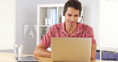 Businessman using headset to talk on the phone