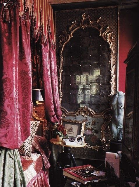 bedroom with ornate mirror and brocade curtains