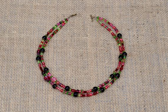 Pretty delicate two strand necklace in  rich tones of pink green and purple  by BijoubeadsLondon £25.00