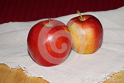 Ripe red apples on a table