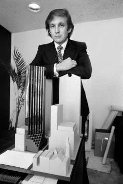Donald Trump w/ a model of Trump Tower. He had that petulant pout even in 1980