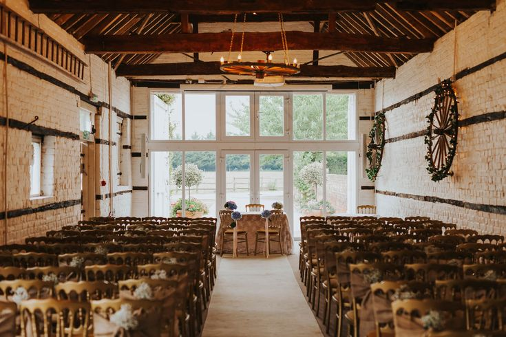 The lovely ceremony barn at @LillibrookeMnr Photo by Benjamin Stuart Photography #weddingphotography #lillibrookemanor #ceremonydecor #weddingvenue #barnwedding #weddingday #gettingmarried