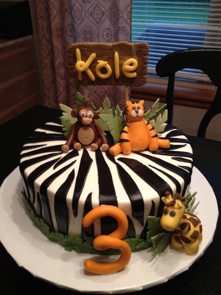 Jungle themed cake. Fondant tiger, monkey and giraffe. Buttercream base with fondant decorations.