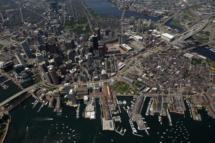 Aerial Shot, Bird's-eye view of Boston-Boston waterfront and view of the Rose Kennedy Greenway along with downtown.