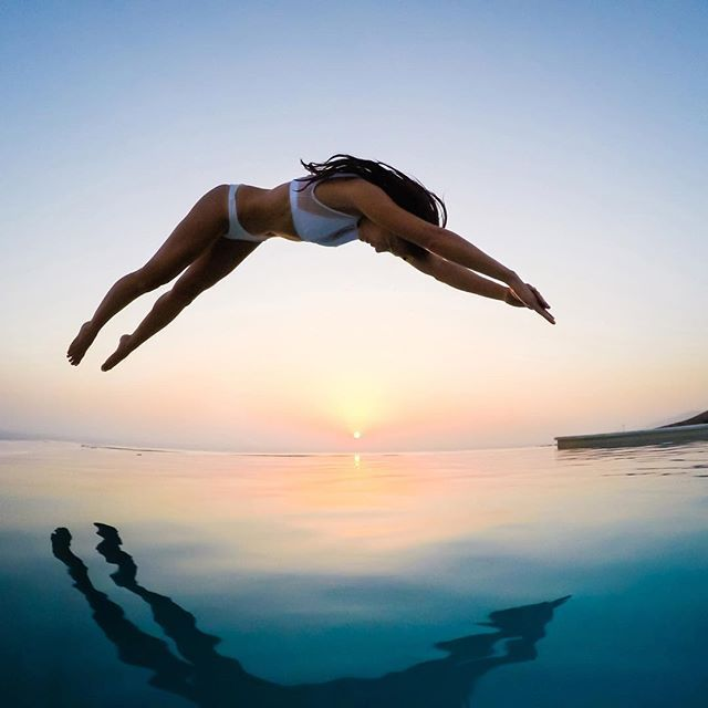 "#GoPro Featured Photographer @travisburkephotography captured this shot at @arpathea in Greece. ""The infinity pool was the perfect place to watch the sun disappear over the ocean and see the stars slowly appear in the night sky. For this shot of @chelseakauai, I positioned the lens of my #HERO5 just above the water, and used the new on-screen Exposure Control to find the perfect exposure before she jumped. About the shot: Burst Mode - 30/3, PT: On, Color - GoPro, WB - Auto, ISO Min - 800…"