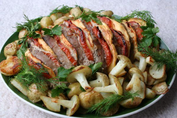 Roast pork with cheese and tomatoes