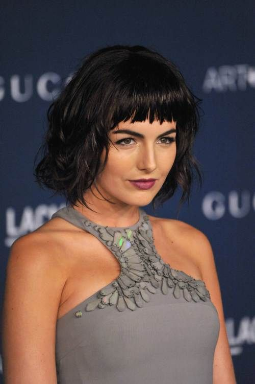 medium haircut for thick hair with bangs ~ pageboy cut with cropped jagged bangs ~ puts emphasis on eyes & cheekbones