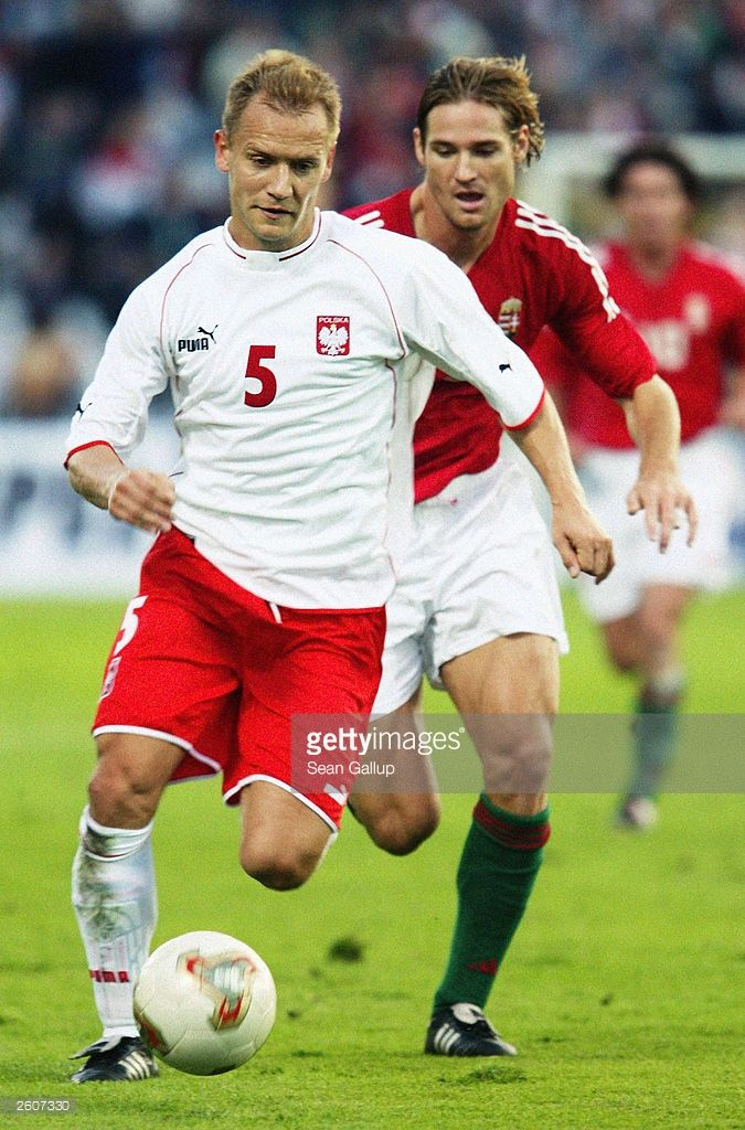 Tomasz Rzasa of Poland runs with the ball during the UEFA European Championships 2004 Group Four Qualifying match between Hungary and Poland held on October 11, 2003 at the Ferenc Puskas Stadium, in Budapest, Hungary. Poland won the match 2-1.