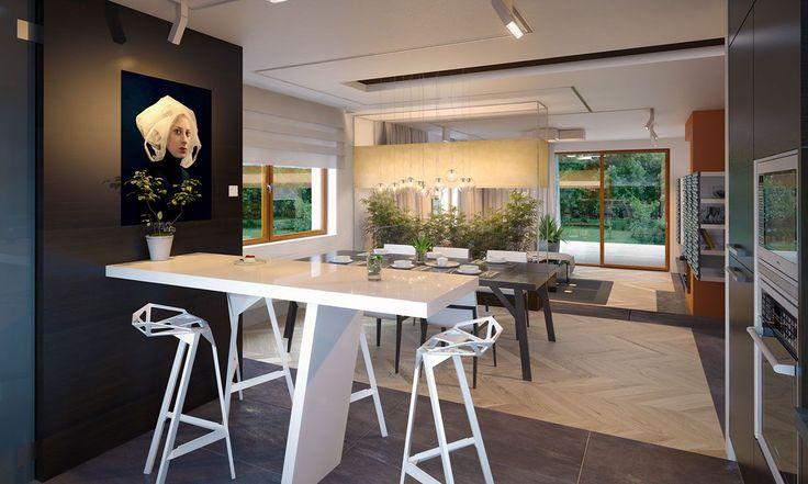 . Duża jadalnia od kuchni oddzielona została barem. Salon ma wysokość 2,98 m przez obniżenie poziomu posadzki względem reszty domu.