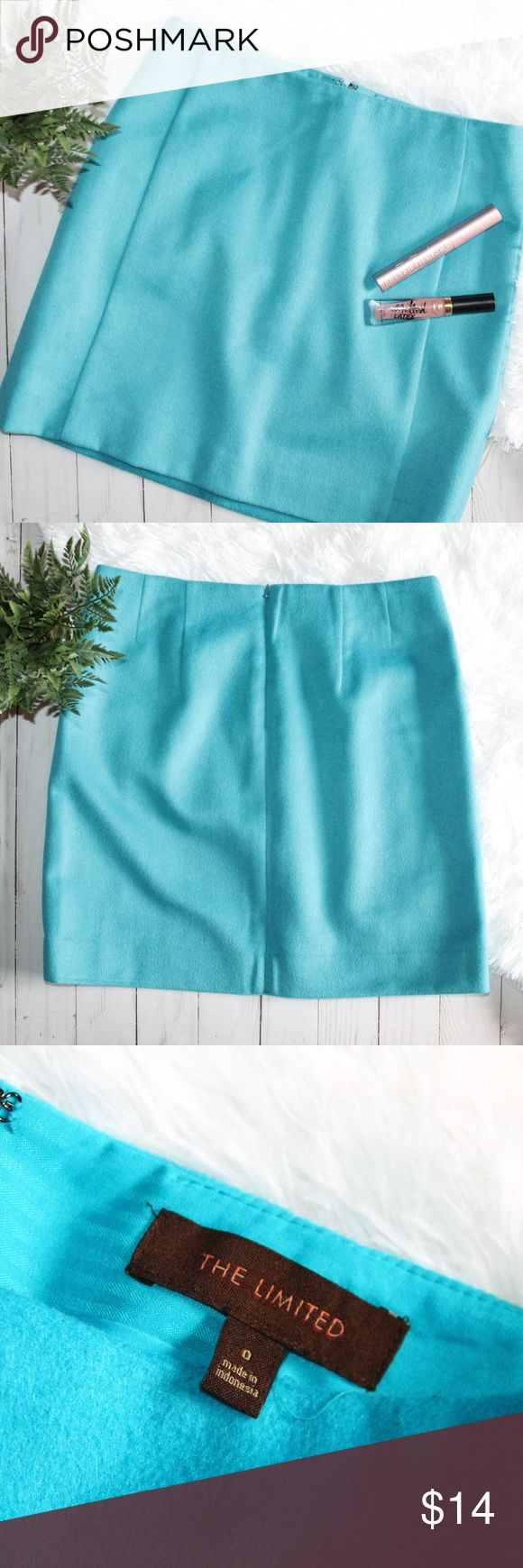 """WOOL BLEND MINI SKIRT - THE LIMITED This is an adorable skirt in a beautiful ocean blue from The Limited. The color is hard to describe - it is a striking, bright shade not quite teal, but not a true blue either. Dry clean only. (It looks, only in certain light, like there is a little scuffed up area in the back, but it is hard to see - it's the last pic. Priced accordingly.) Back zip. Wool and polyester. Lined.  Length: 16"""" Waist laying flat: 14.25"""" The Limited Skirts Mini"""