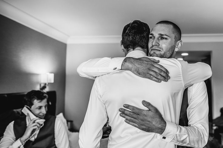 Man hugs! grooms can do emotion too, in fact they do more than the girls!