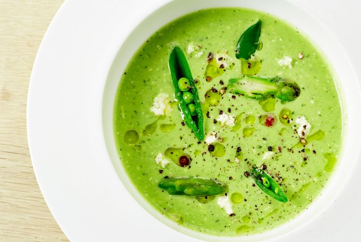 Cold summer soup with green vegetables (peas, asparagus, cucumber) and mint