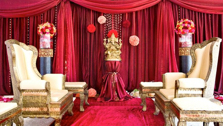 South Asian Wedding Reception Lounge with Red Drapes and White Chairs