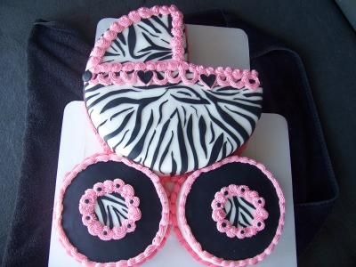 Zebra Baby Carriage Cake: For this Zebra Baby Carriage Cake...  I used a 14 inch round cake pan to make the carriage.  The cake is double layer, with butter cream between layers.