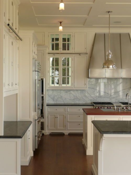"""F """"Pointing"""" was used in this all white kitchen with Calcutta slab back splash and black granite  counter tops."""