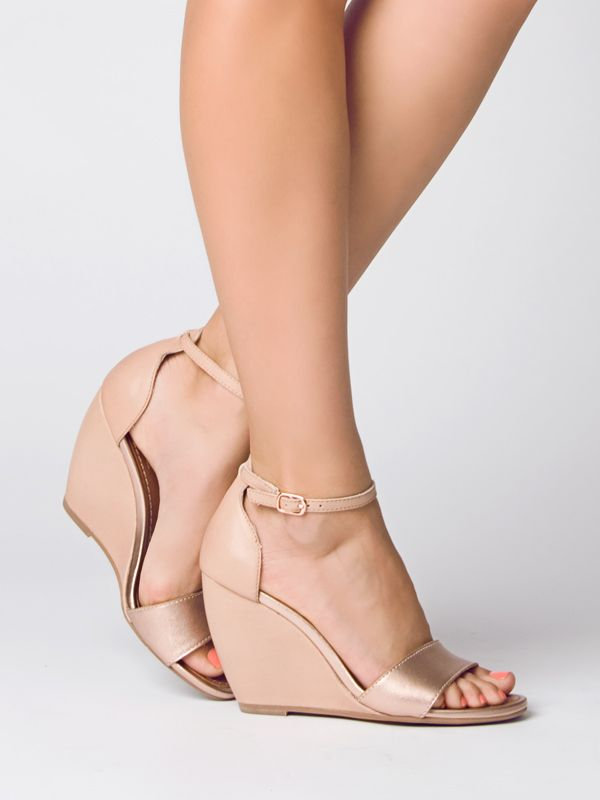 Dear stylist-- I love wedges, and neutral colors would be great to go with anything- km