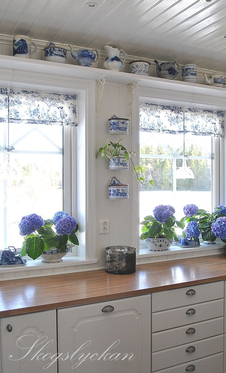 Blue and white kitchen with toile valances and wall mounted salt boxes -- Ateljé Skogslyckan