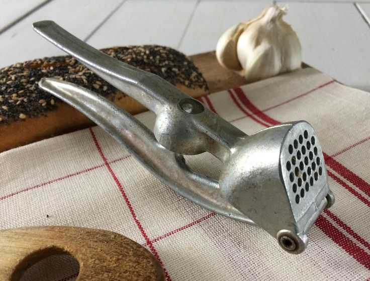 1950's garlic press and deseeder.Vintage French multi-use kitchen tool.Aluminum rustic garlic crusher and Olive piper.French country kitchen by frenchvintagebazaar on Etsy