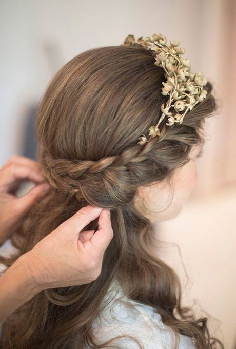 Double-Braided Half-Up Hairstyle With a Tiara. Even more regal than a gilded tiara? A double-braided band supporting it.
