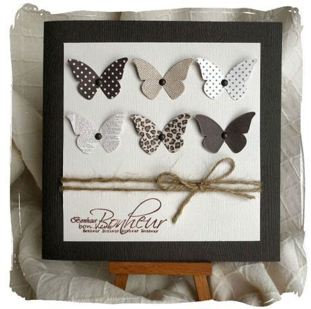 handmade card ... butterfly collection ... browns ... punched from different patterned papers .... good idea to use pretty scraps ... like the single brad pinning then down...