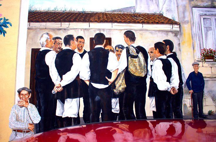 Sulle Mura di Muros un murales rappresentante il coro prestigioso del paesetto sito in cima ad una collina photo by loybillyrock