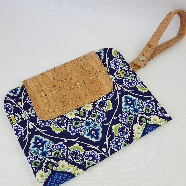 Blue and green retro print fabric nappy wallet with cork fabric finish. Nappy clutch. Diaper clutch. Nappy bag