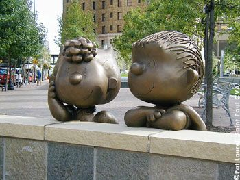 Pictured: *Sally and Linus*  St. Paul, Minnesota  |Peanuts Sculptures ~~  In an effort to honor Saint Paul native Charles M. Schulz, creator of the 'Peanuts' comic strip, five-foot statues of the Peanuts characters were decorated each summer from 2000 through 2004 and placed throughout the city. The 'Peanuts on Parade'tra- dition was patterned after the successful 'Cows on Parade' in Chicago.|