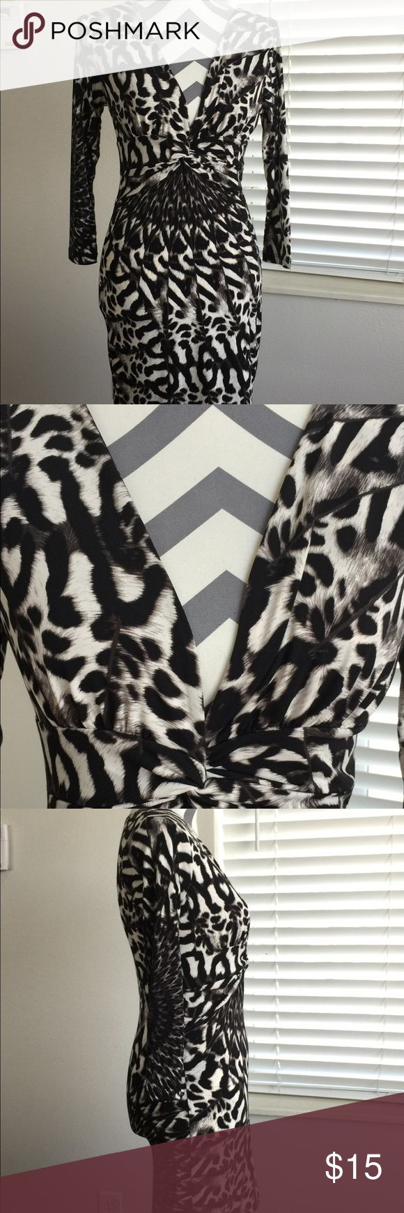 """Animal Print Bodycon Dress NWOT Black and white Animal Print bodycon dress shows off your figure! Plunging V-Neck with center ruching. 3/4 sleeves. Length approximately 24"""" from underarm to hem. Material is polyester, spandex and elastano. Size Medium. Bought in California boutique but Never worn. Perfect for clubs, night out, or special occasion Symphony Dresses Mini"""