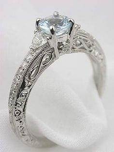 Intricately carved aquamarine/diamond engagement ring. Vintage styles are definitely the best.