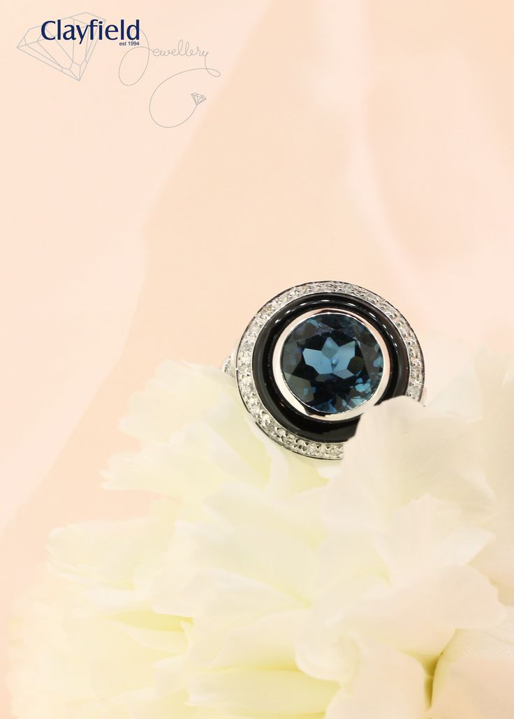 London blue topaz ring, featuring onyx and a diamond halo. By Clayfield Jewellery in Nundah Village, North Brisbane.