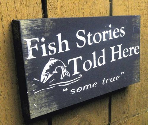 """This rustic wooden pallet sign reads """"""""Fish Storied told here, """""""" and can hang on the wall or stand up on the shelf. What a great addition to your cabin decor!It would also be the perfect rustic déco"""