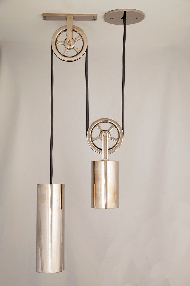 """Pendant: 3"""" x 9"""" Counterweight: 3"""" x 5.25"""" Pulley: 4"""" diameter Length: please specify  Available in Raw Steel, Blackened Steel or Solid Bronze in any of our  finishes.  The Sun Valley Bronze Pulley Pendant is a modern version of a classic  design. The pendant is counterbalanced by a weight, which operates smoothly  on a pulley system."""