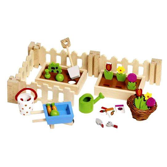 Wooden dollhouse vegetable garden. Fuori dalla casa delle bambole in legno, sia nella bella che nella brutta stagione, è possibile piantare e coltivare, carote, fiori e verdure. Naturalmente tutti in legno. Puoi acquistare questo orto per casa delle bambole su http://www.giochiecologici.it/p/676/orto-per-casa-bambole