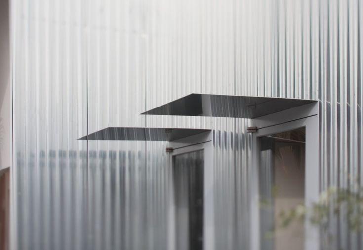 metallic palette: stainless steel awning, corrugated metal cladding