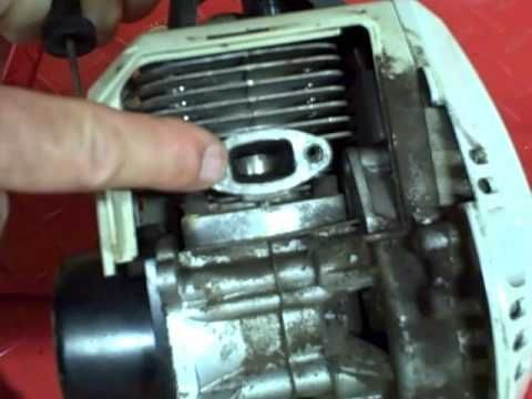 Small Engine Repair: Cleaning Carbon Buildup on the Exhaust Port & Muffler on a 2 Stroke Engine. If you need help, or have questions call 828-245-9566.