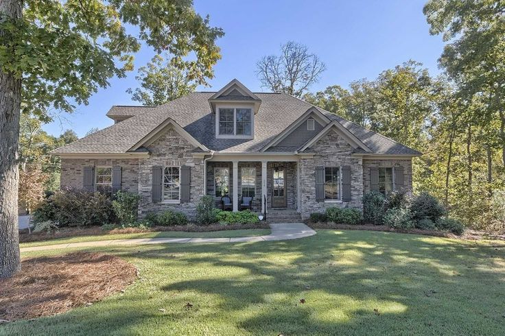 Traditional Exterior of Home with Fence, exterior stone floors, Pathway Shutters are Sea Serpent SW 7615