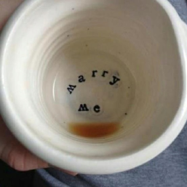 """There is something extremely special, about a low-key proposal. This is adorable! And having the """"marry me"""" cup forever is a great touch!"""