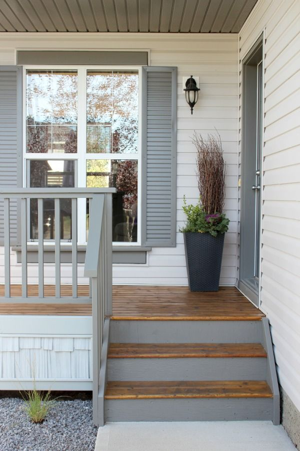 Paint porch a grey slightly lighter than the charcoal planned for front door. Add (DIY) decorative shutters in same color.