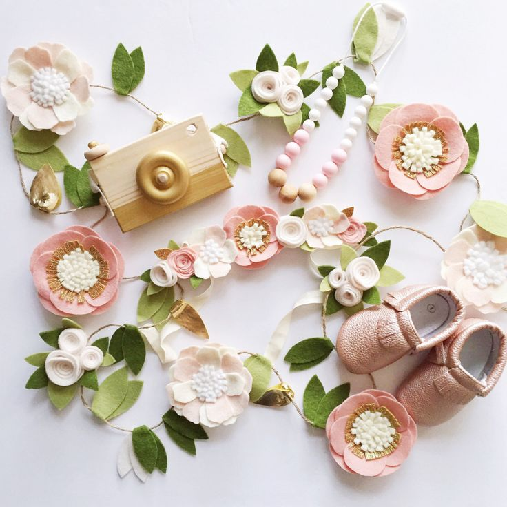 Gorgeous felt flower garland in blush pink, gold, white, Ivory, and other neutrals. With green and gold leaves. Colors can be customized via direct message! Everything is hand cut from high quality wool blend felt. 6 ft garland is pictured. 9 flowers are included on the 6ft garland. Flowers and leaves are attached to twine. 6ft is the length of the flowers/leaves. Extra twine on either end to hang! Option for a Bundle with matching crown listed. I also have a very sturdy wood covered wire…
