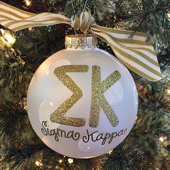 Sigma Kappa - Glitter Gold Ornament: The Sigma Kappa Gold Glitter Ornament is a must-have for any stylish sorority woman. With its classic white stripe ribbon and sparkly gold greek lettering, this ornament is the perfect holiday gift.  Comes packaged in a coordinating gift box for perfect present presentation