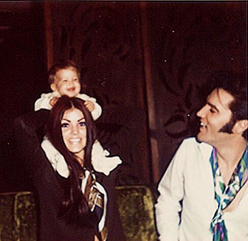 Elvis and Priscilla Presley playing with Lisa...