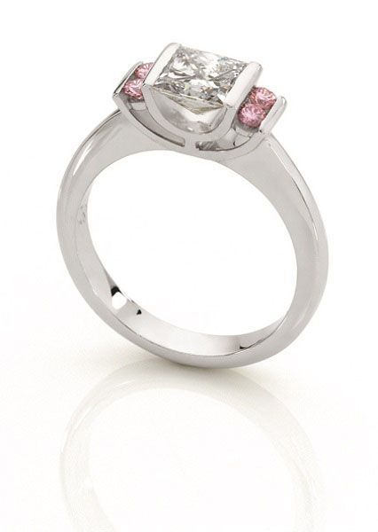 Princess cut white diamond ring with round brilliant cut natural Australian pink diamonds on the sides