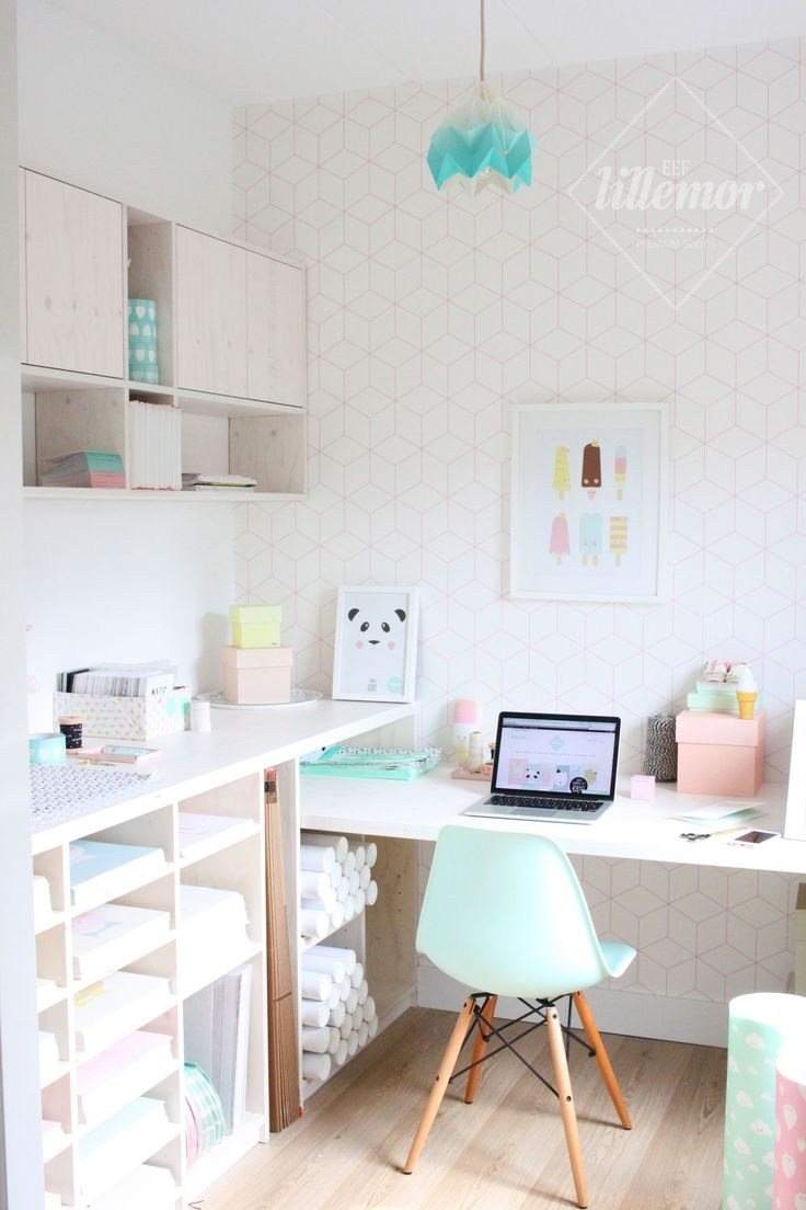 Pastel inspired home office with loads of clever storage and space for working.
