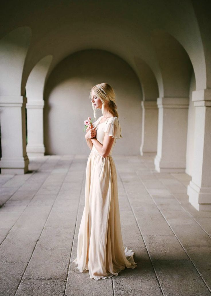 Modest wedding dress with flutter sleeves by Alta Moda, photo by Mandi Nelson